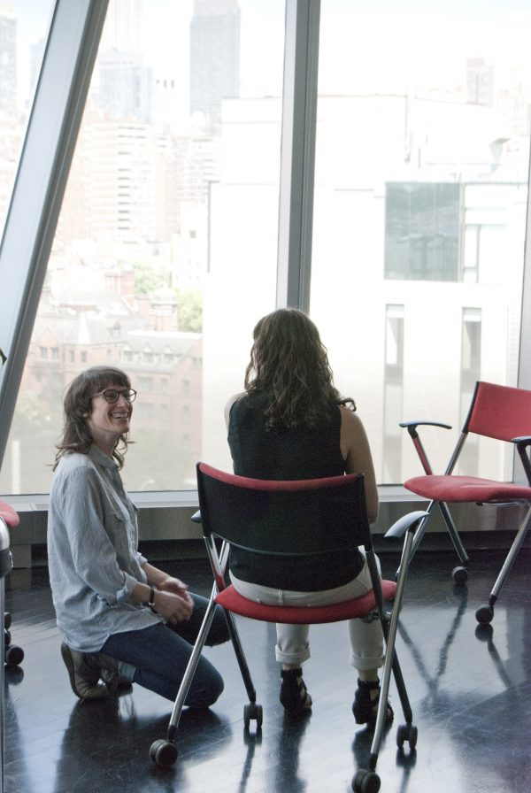Two students practice techniques both as client and therapist.